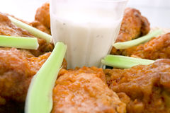 Hot Chicken Wings. Clouse-up of Hot Chicken Wings with celery and dip - Selective focus on center stock photos