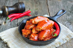 Hot Chicken Wings Barbecue in Black Saucepan isolated Stock Photos
