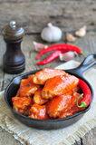 Hot Chicken Wings Barbecue in Black Saucepan isolated Stock Photo