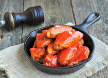 Hot Chicken Wings Barbecue in Black Saucepan isolated Stock Image