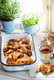 Hot chicken wings with barbecue sauce in rustic kitchen Stock Image