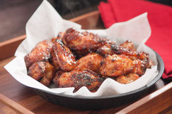 Hot chicken wings in a basket Royalty Free Stock Images