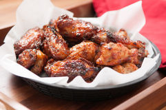 Hot chicken wings in a basket Stock Photography