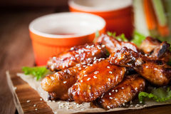 Hot chicken wings cooked with honey and soy,  topped with sesame Stock Photo