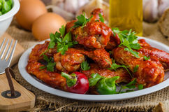 Hot chicken wings. With domestic bread from sourdough rye, little lamb lettuce salad, place for your text, advertising royalty free stock images