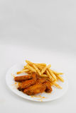 Hot Chicken Wings and French Fries. A Plate of Hot Chicken Wings and French Fries stock photography