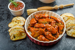 Hot chicken wings, habanero souce, salad Royalty Free Stock Image