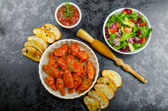 Hot chicken wings, habanero souce, salad Stock Photo