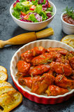 Hot chicken wings, habanero souce, salad Royalty Free Stock Images