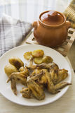 Hot chicken wings on table with potato Royalty Free Stock Photo