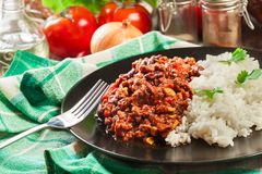 Hot chili con carne with ground beef, beans, tomatoes and corn served with rice Royalty Free Stock Photo