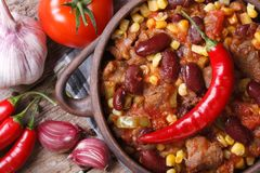 Hot chili con carne in a pot macro top view Royalty Free Stock Images