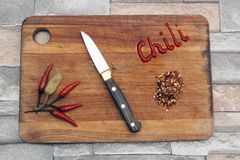 Hot chili papers on a cutting board Stock Photo