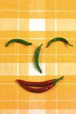 Hot chili pepper face Stock Image