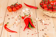 Hot chili pepper on wooden texture. Royalty Free Stock Photography