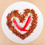 Hot chili peppers arranged in heart shape Stock Photo