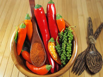 Hot Chili Peppers in bowl over wooden background Royalty Free Stock Photography