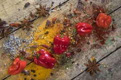 Hot chili peppers on a rustic farmhouse table Stock Image