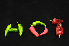 Hot Chili Peppers. Some Very Hot Chili Peppers Ready to Cook Royalty Free Stock Images