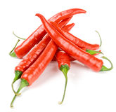 Hot chili peppers on white surface Stock Photos