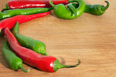 Hot chili peppers on on wood board. Hot chili peppers on on wooden board Stock Photography