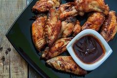 Bufalo style chicken wings. Hot chili sauce buffalo style chicken wings Royalty Free Stock Photos