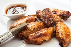 Bufalo style chicken wings. Hot chili sauce buffalo style chicken wings Royalty Free Stock Images