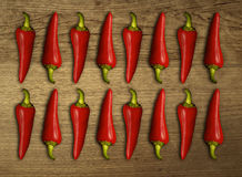 Hot chili on wood table. Arrange chili in unique pattern Stock Images