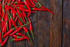 Hot chilli. Red hot chilli peppers on a table stock photo