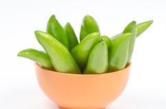 Hot Chillies (Jalapenos) in Bowl. Whole chillies (Jalapenos) in a bowl kept on white background Stock Photos