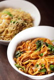 Hot chinese spaghetti with garnish Stock Photo