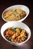 Hot chinese spaghetti with garnish Stock Photos