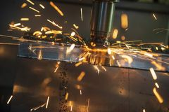 The hot chip on CNC machine from tool wear. The CNC milling machine cutting the mold part with the index-able radius end mill tool in roughing process royalty free stock photos