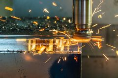 The hot chip on CNC machine from tool wear. The CNC milling machine cutting the mold part with the index-able radius end mill tool in roughing process royalty free stock images