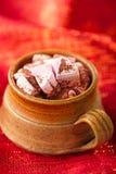 Hot chocolat vintage mug on red glitter backdrop Stock Photos