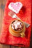 Hot chocolat vintage mug on red glitter backdrop Royalty Free Stock Images