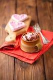 Hot chocolat vintage mug on red glitter backdrop Stock Image