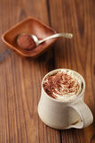 Hot chocolat vintage mug, topping with cream and grated chocolat Stock Photo