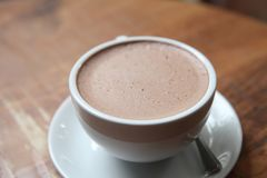 Hot chocolate. On a cup royalty free stock photo