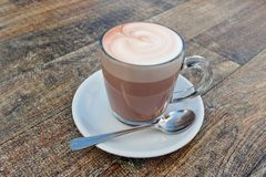 Hot Chocolate. A cup of hot chocolate drink on a wooden table in a cafe/restaurant Royalty Free Stock Photos