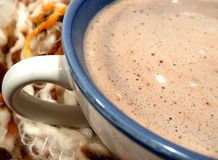 Hot Chocolate. Cup of hot chocolate wrapped warm in scarf Royalty Free Stock Images