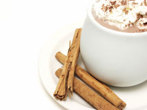 Hot Chocolate. With cinnamon sticks on white with a white isolated background Royalty Free Stock Photo