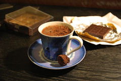 Hot chocolate. A cup of hot chocolate with some other sweet and chocolaty things Stock Photo