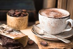 Hot Chocolate And Chocolate Pieces Over Rustic Wooden Background. Homemade Hot Chocolate Drink For Christmas And Winter Holidays Stock Image