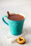 Hot chocolate and biscuit Stock Images