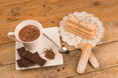 Hot chocolate and biscuits Stock Images