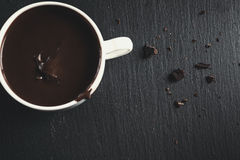 Hot chocolate with bitter chocolate On a black chalkboard. Hot chocolate with bitter chocolate. On a black chalkboard Royalty Free Stock Images