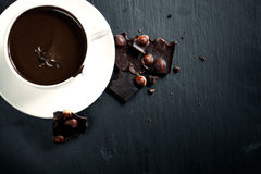 Hot chocolate with bitter chocolate On a black chalkboard. Hot chocolate with bitter chocolate. On a black chalkboard Royalty Free Stock Image