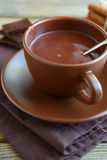 Hot chocolate in a brown cup Stock Photography