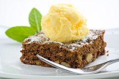 Hot chocolate brownie with walnuts and vanilla royalty free stock images